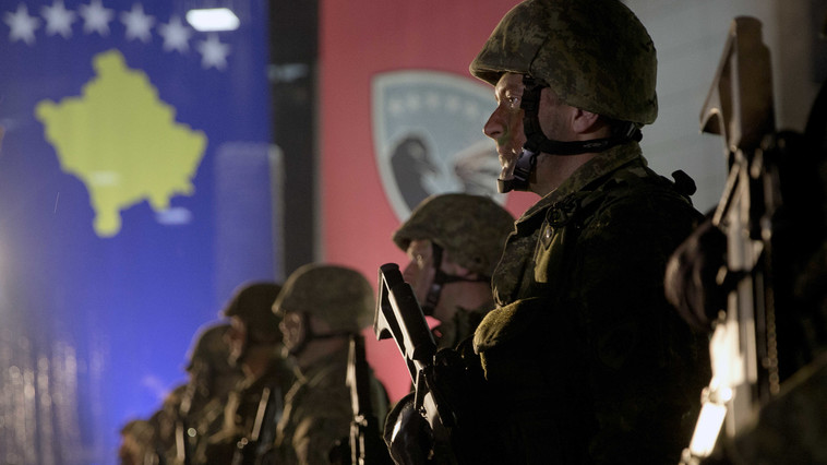 Soldiers of Kosovo Security Force line up to displaying their equipment at the end of the army formation ceremony in capital Pristina, Kosovo on Friday, Dec. 14, 2018. Kosovo's parliament convened on Friday to approve the formation of an army, a move that has angered Serbia which says it would threaten peace in the war-scarred region. (AP Photo/Visar Kryeziu)
